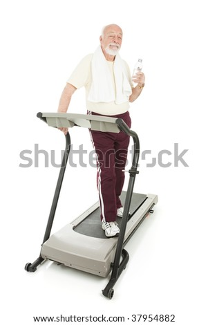 Senior man on the treadmill takes a water break.  Full body isolated on white.