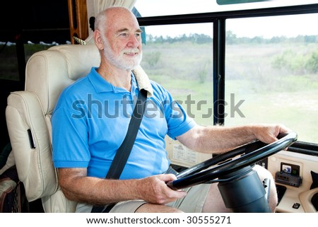 Senior man on vacation driving his motor home.