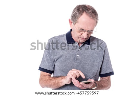 Senior man operating his new cell phone