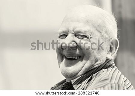 Senior man outside in the nature smiling - stock photo
