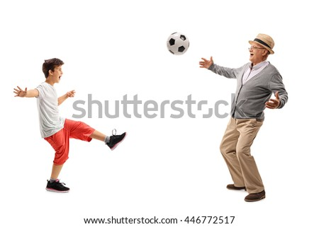 Senior man playing football with his grandson isolated on white background
