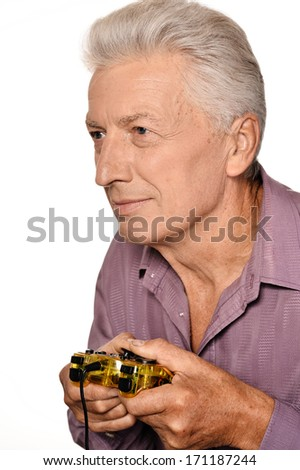 Senior man playing video game on white background - stock photo