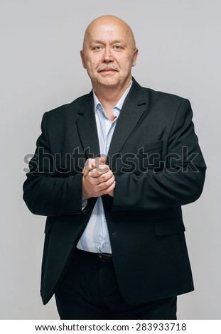 Senior man portrait smiling in suit