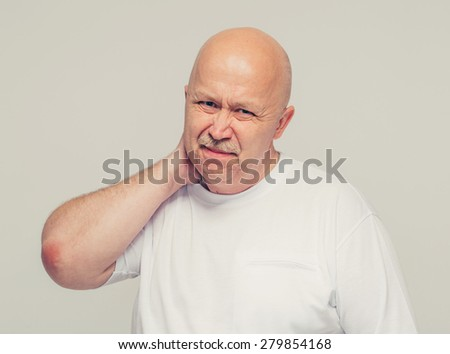 Senior man portrait with neck pain on white background