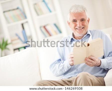 Senior Man Reading a Book - stock photo