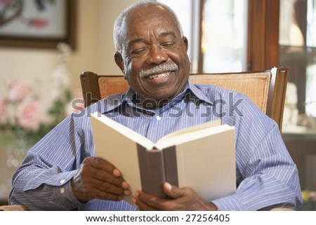 Senior man reading book - stock photo