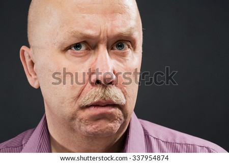 senior man serious portrait with mustache and bald - stock photo