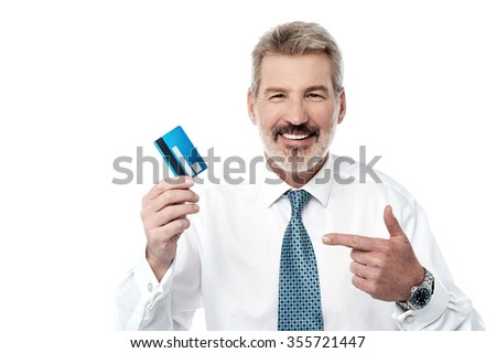 Senior man showing and pointing debit card
