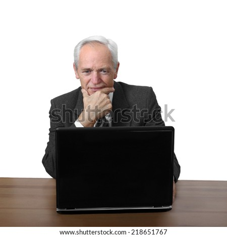 Senior man sits and thoughtfully looks at notebook isolated on white background