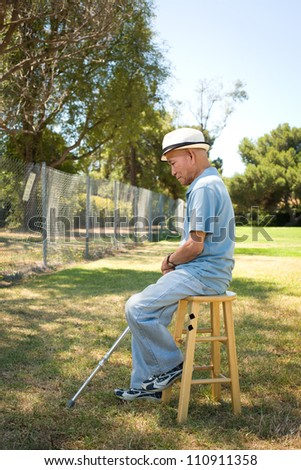 Senior man sitting on outdoor chair