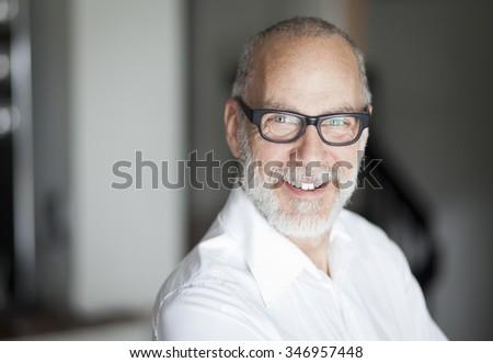 Senior Man Smiling At The Camera - stock photo