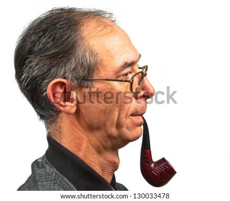 Senior man smoking pipe isolated over white - stock photo
