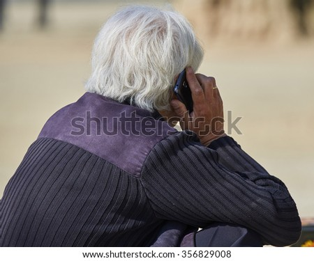 Senior man speaking on the smartphone - stock photo