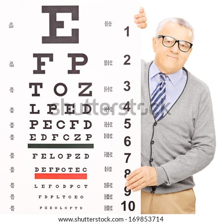 Senior man standing behind eyesight test, isolated on white background, shot with a tilt and shift lens