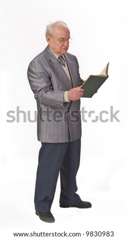 Senior man standing up and reading a book.