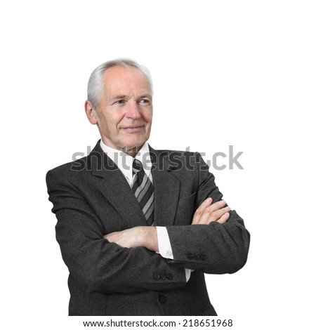 Senior man stands seriously with arms folded isolated on white background