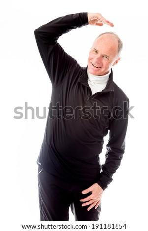 Senior man stretching and smiling - stock photo
