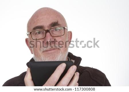 Senior Man using a tablet PC - stock photo
