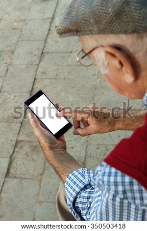 senior man using Cell phone. He is 75 years old - stock photo
