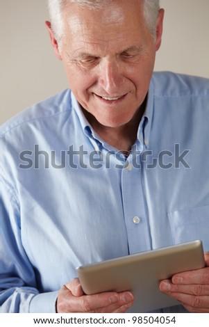 Senior man using tablet - stock photo