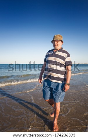 Senior man walking on the beach