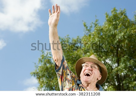 Senior man waving - stock photo