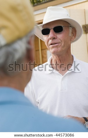 Senior man wearing sunglasses - stock photo