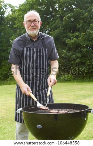 Senior man with a barbeque - stock photo