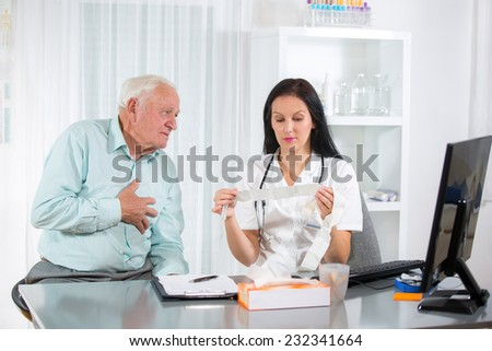 Senior man with a cardiologist - stock photo