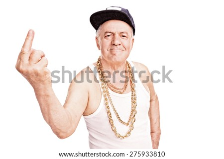Senior man with a hip-hop cap and a golden chain, giving the finger and looking at the camera isolated on white background - stock photo