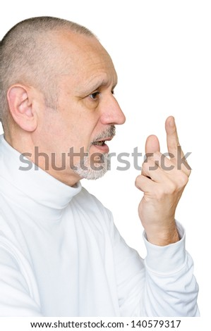 Senior man with a serious and authoritarian face asking for attention to the public listening to him and speaking about a precise point, pointing the forefinger up. Isolated on white background.
