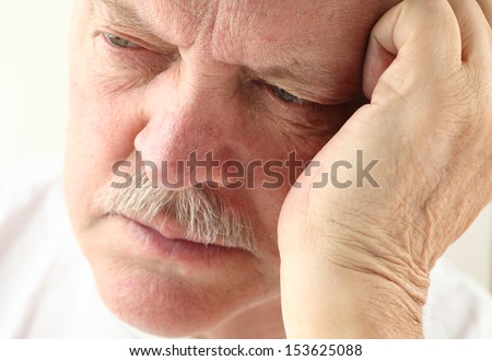 senior man with an unhappy expression - stock photo