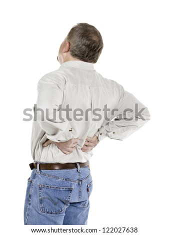 Senior man with back pain in a close-up image - stock photo
