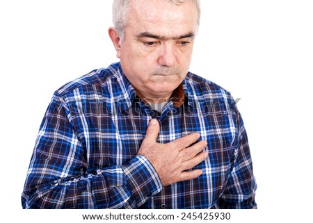 Senior man with chest pain isolated on white background  - stock photo