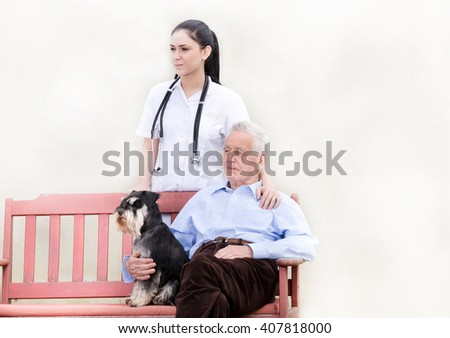 Senior man with dog sitting on the bench while young nurse standing behind him and holding her hand on his shoulder - stock photo