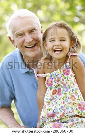 Senior man with granddaughter - stock photo