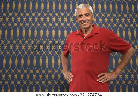 Senior man with hands on hips - stock photo