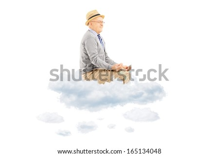 Senior man with hat seated on clouds meditating isolated on white background - stock photo