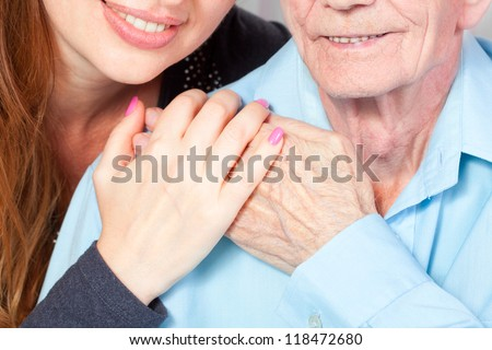Senior man with her caregiver at home