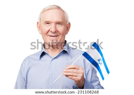 Senior man with Israeli flag. Cheerful senior man holding flag of Israel and smiling at camera while standing against white background - stock photo