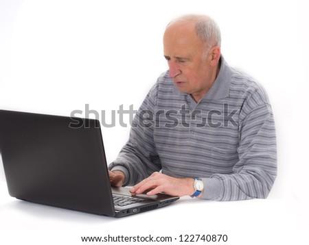 senior man with laptop, isolated on the white - stock photo