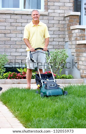Senior man with lawn trimmer. Summer housework.