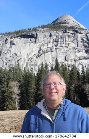 Senior Man with North Dome Yosemite National Park California USA