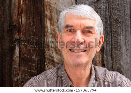Senior man with orthodontic braces. - stock photo