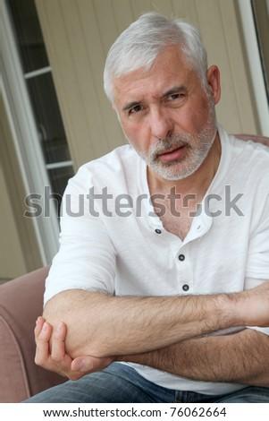 Senior man with osteoarthritis pain - stock photo
