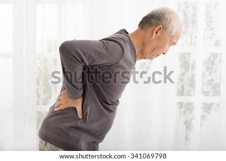 senior man with Pain in back - stock photo