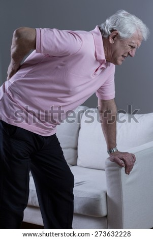 Senior man with painful lumbar discopathy - stock photo