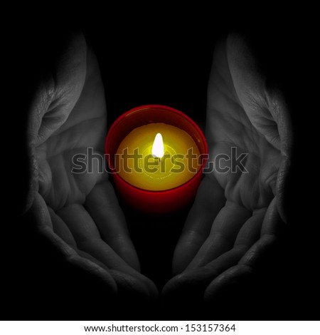 Senior man with remembrance, votive candle - ideal All Saints Day etc. Note: selective colour. - stock photo