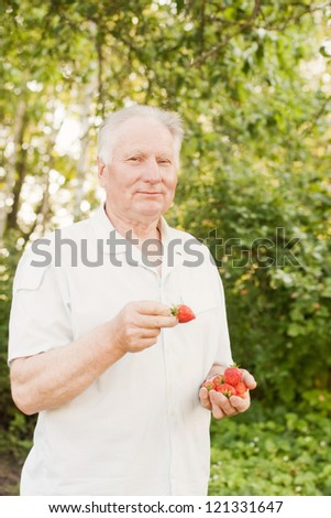 senior man with strawberry