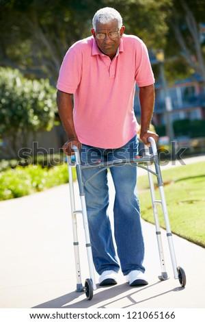 Senior Man Walking Frame Stock Photo (Royalty Free) 121065166 ...